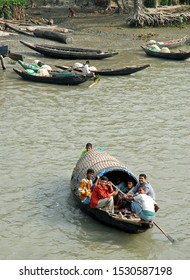 Ganges Delta / Bangladesh - Feb 16 2006: A group of men on a small boat on the river in the Ganges Delta. Waterways of the Ganges Delta in southern Bangladesh.