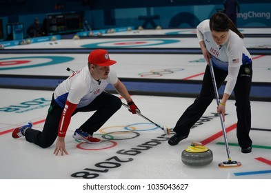 GANGNEUNG, SOUTH KOREA - FEBRUARY 10, 2018: United States' siblings Matt and Becca Hamilton compete during a mixed doubles round robin curling match at the 2018 Winter Olympics