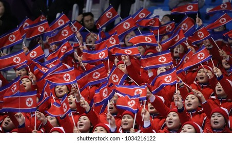 GANGNEUNG, SOUTH KOREA - FEBRUARY 12, 2018:  North Korea's cheering squad perform during Pair Skating Free Skating in Gangneung Ice Arena at the 2018 Winter Olympics