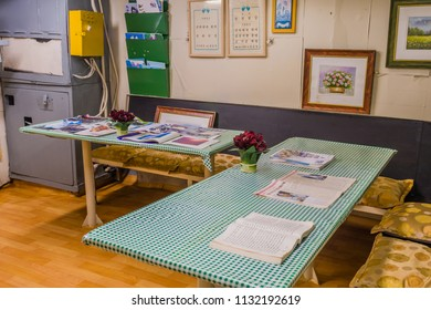 Gangneung, South Korea; July 4, 2018: Interior of  saloon with magazines om tables inside battleship on display at Unification Park.
