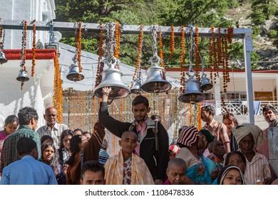 GANGOTRI, INDIA - MAY 23rd 2013 - Hindu devotees ring temple bells at Gangotri on May 23rd 2013.