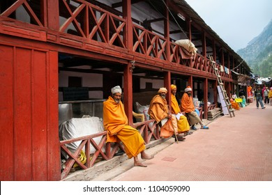 Gangotri, Uttarakhand, India - May 08, 2012 : Sadhus sitting at way to gangotri temple. Normally a sadhu is a monk, renounced, renounced material enjoyment. In India from 4 to 5 million sadhu.