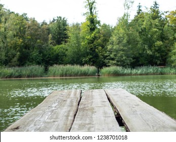 a gangplank over a green lake in switzerland