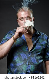 Gangster mafia man in casual outfit smoking cigar looking tough isolated on dark background