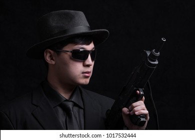 gangster in retro style on a black background, an FBI agent, a spy, a CIA agent