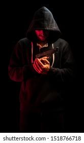 Gangster from slums holding pistol beretta