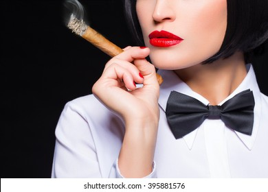 Gangster woman with cigar smoking, white shirt and tuxedo