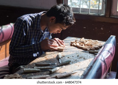 GANGTOK, INDIA - DECEMBER 3, 2016: trainee undergoing training in wood carving at the Directorate of Handicrafts & Handlooms
