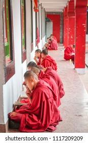 Gangtok, Sikkim / India - April 13,2018 : Young tibetan monks pray and concentrate before examination at Rumtek monastry tibetan temple