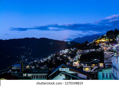 Gangtok, Sikkim, India - December 12, 2018: Gangtok City in the evening with lamp lights from houses, Gangtok, Sikkim, India