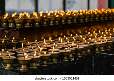 GANGTOK, SIKKIM, INDIA - JANUARY 06, 2016: Prayer lamps inside the Rumtek monastery in the city of Gangtok in the state of Sikkim in India