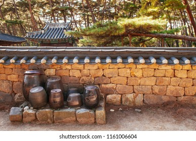 Gangwon-do, South Korea - Old Kimchi pots at Danjong banishment place in pine forest at Cheongryeongpo cape. Famous tourist attraction of Yeongwol town.