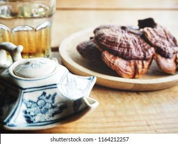 Ganoderma Lucidum - Ling Zhi Mushroom and tea pot