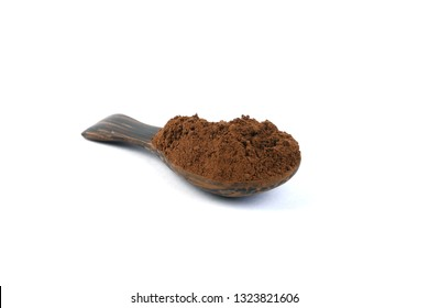 Ganoderma Lucidum Mushroom powder in a wooden spoon isolated on white background.
