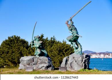GanRyu-Jima, Yamakuchi / Japan - February 2, 2017: The statue about the historical famous fighting duel between Miyamoto Musashi and Sasaki Kojiro at Ganryu island in Yamaguchi, Japan
