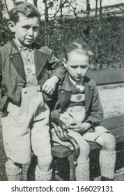 GANSERNDORF, AUSTRIA, CIRCA 1930s: vintage photo of brothers in Tyrolean outfit, Ganserndorf, Austria , circa 1930s