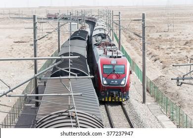 GANSU, CHINA - Apr 13 2015: China Railways HXD1D electric locomotive in Jiayuguan, Gansu, China. HXD1D used on the China Railway network.