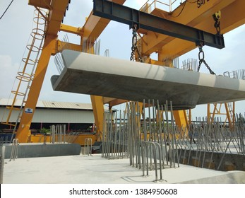 Gantry crane is lifting the precast concrete of pier cap for one of elevated structure project in Malaysia.