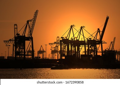 Gantry cranes, harbour cranes, container terminal, sunset, port, Hamburg, Germany