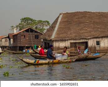 Ganvie, Benin – 31/12/2019. Village on a lake, people travel by boat and live in houses on stakes.