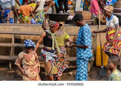 GANVIE, BENIN - JAN 11, 2017: Unidentified Beninese people at the port of the lake Nokwe. Benin people suffer of poverty due to the bad economy.