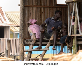 GANVIE, BENIN - JAN 11, 2017: Unidentified Beninese people in a village over the lake Nokwe. Benin people suffer of poverty due to the bad economy.