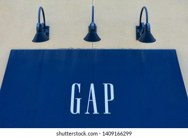 GAP trademark logo on retail store. GAP is American worldwide clothing and accessories retailer - Los Gatos, California, USA - May 27, 2019