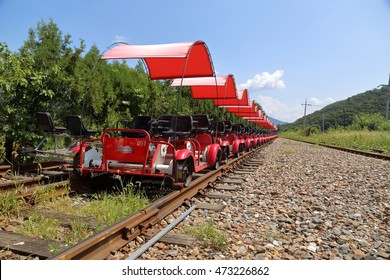 GAPYEONG, REPUBLIC OF KOREA - AUG 22, 2016: Rail Bikes lined up waiting for Riders at RAIL PARK, which is a Comapany to manage Rail Bikes on Abandoned Railway in Gapyeong-gun.