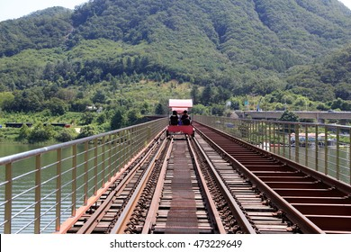 GAPYEONG, REPUBLIC OF KOREA - AUG 22, 2016: A Family riding Rail Bike on the old Railway road. RAIL PARK which is a Company to manage Rail Bikes serves Great Leisure Activity for Family.