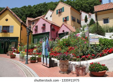Gapyeong, South Korea - June 16 2018: Colorful European Buildings with Beautiful Flowers in Petite France. Petite France Is a Small French Cultural Village.