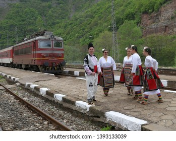 Gara Bov, Bulgaria - May 4, 2019: People dressed with traditional Bulgarian authentic folklore clothes dance Bulgarian horo in Gara Bov, Bulgaria