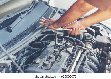 Garage auto car service professional mechanic man checking and fixing car engine machine. Auto mobile Mechanic Common Car Repairs. Car Service Concept.
