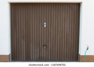 Garage with brown metal gate