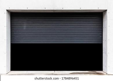 Garage at the building that opens the black shutter door