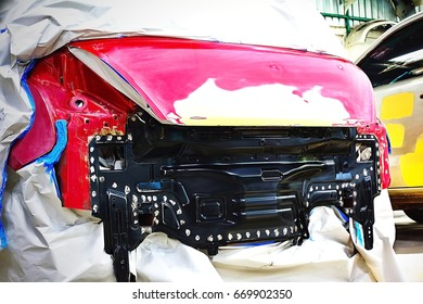 Garage car body work auto repair paint after the accident during the spraying