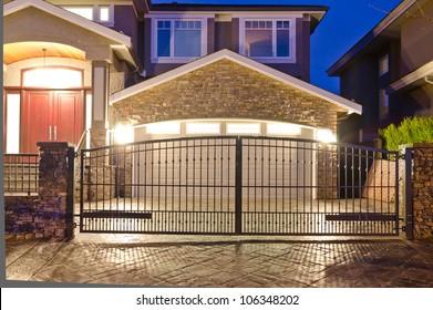 Garage door behind the metal gates at night