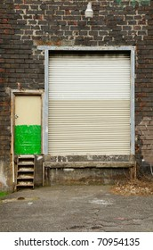 Garage door and man entry to an warehouse in the industrial area of North Portland Oregon