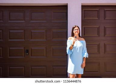Sexy woman installing garage door opener