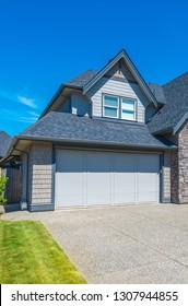 Garage, garage doors and driveway.