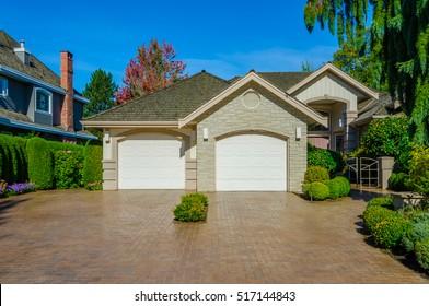 Garage, garage doors with long driveway.