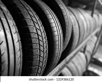 garage equipment car jack tyres black and white picture black tyres rubber bokeh background