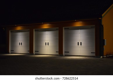 Garage gate with three ports and outdoor light