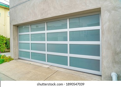 Garage of house in Long Beach California with wide frosted glass paned door