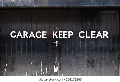 Garage keep clear sign on black doors