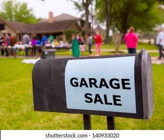 Garage sale in an american weekend on the yard green lawn