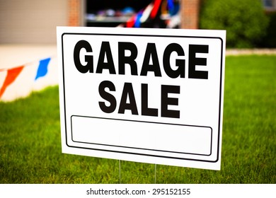 Garage sale sign on the front yard of a suburban house