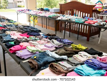 Garage sale tables with clothing