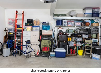 Garage storage shelves with vintage objects and equipment.