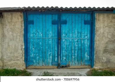 Garage with wooden door