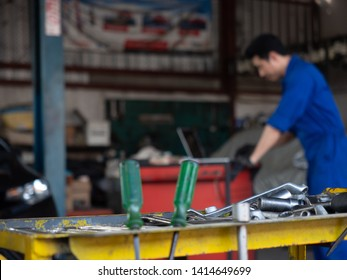 garage worker concept.handsome asia man automotive mechanic in garage with copy space.